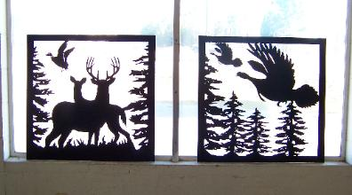 Deer and turkey signs and metal silhouettes