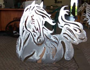Horse cut from metal at plasma designs.