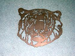 Tiger silhouette made from metal at plasma designs for art.